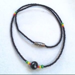 "18"" black beaded necklace w/red yellow green beads"